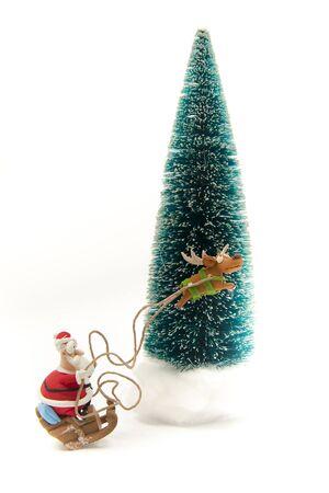 Santa riding on sleigh near Christmas tree Stock Photo - 16689319