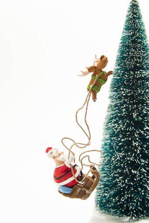 Santa riding on Sleigh along Christmas tree Stock Photo - 16689325