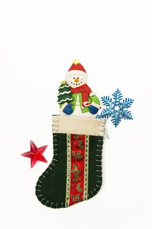 One snow man in the green Christmas sock Stock Photo - 16689320