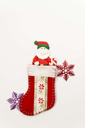 Santa Claus in Christmas sock with snow flake Stock Photo - 16689322