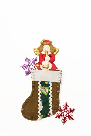 Red Angel in brown Christmas sock with snowflake Stock Photo - 16689316