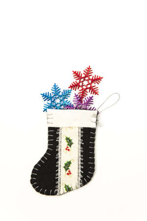 snowflake in green decoration Christmas sock Stock Photo - 16689318