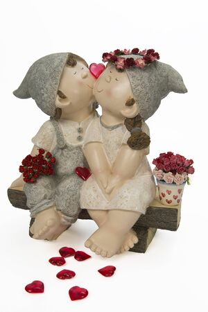 Boy and girl kissing with red heart and roses Stock Photo - 17909300