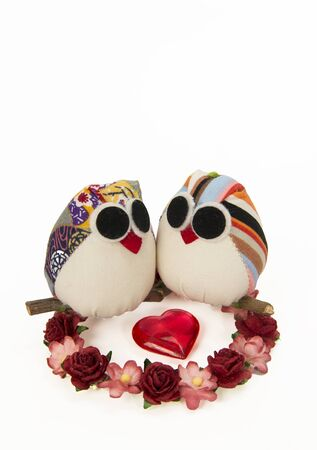 Two fabric fancy owls in circle of flower and one plastic heart shape Stock Photo - 17909296