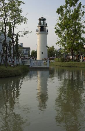 White light house along small river Stock Photo - 18594967