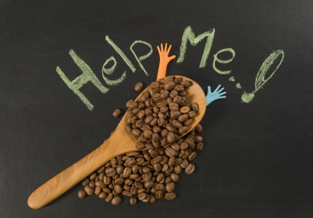 Coffee bean in wooden spoon with help me hand writing Stock Photo - 19492499