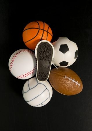 foot print on shoe among balls in black background Stock Photo - 19835394