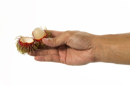 One hand with opening rambutan isolated on white background Stock Photo - 19835418