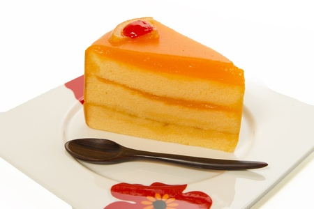 one piece of orange cake with wooden small spoon Stock Photo - 20761576