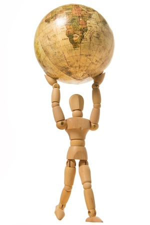 Wooden human model hold the world isolated on white background Stock Photo - 20761581