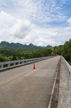 Long bridge cross the river into the mountain Stock Photo - 21075787