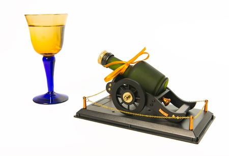 Green whisky bottle on artillery platform with blue and yellow glasses Stock Photo - 21075791