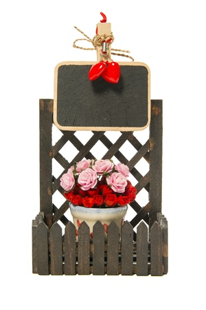 Small black board on the fence with roses and heart shapes Stock Photo - 21493058