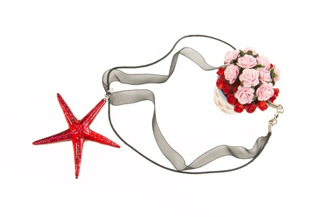 Red crystal star fish necklace with bush of roses Stock Photo - 21493062