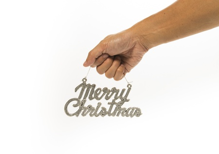 One hand holding silver Merry Christmas sign Stock Photo - 21493064
