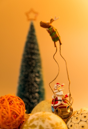 Santa with one reindeer on many balls with Christmas Tree Stock Photo - 22012985