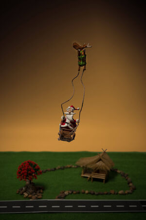 Santa and reindeer fly over Thai house for Christmas eve Stock Photo - 23031141
