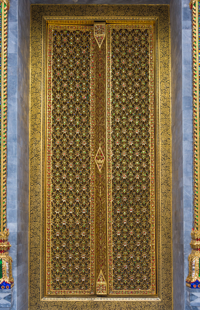 Thai Temple carving door with golden decoration