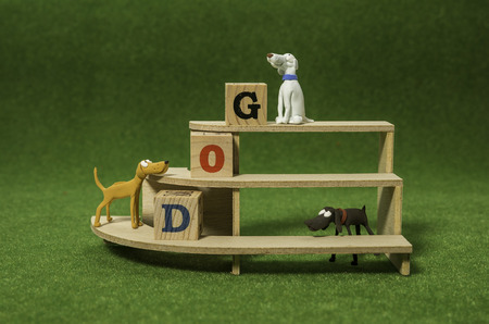 Clay dog on the shelf with wooden alphabet cube Stock Photo