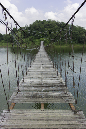 Broken bridge across the river Stock Photo