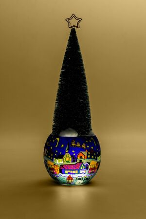 Christmas tree in the painting cup