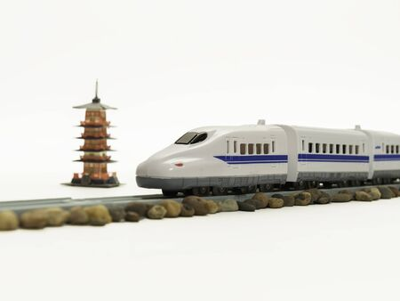 high speed train: High speed train pass through five storied pagoda Stock Photo