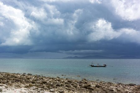 fisherman boat hide from big rain storm