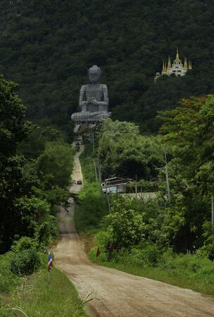 Buddha statue and temple on the mountain