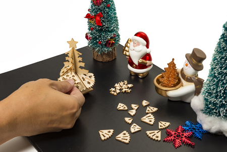Assemble Christmas tree by hand