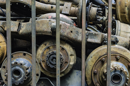 Old stack of axle in bar Stock Photo