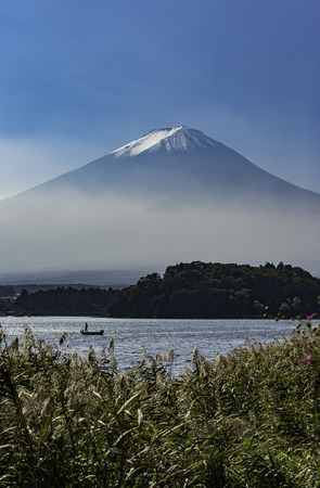 Fisherman on fishing boat in Lake Kawaguchi