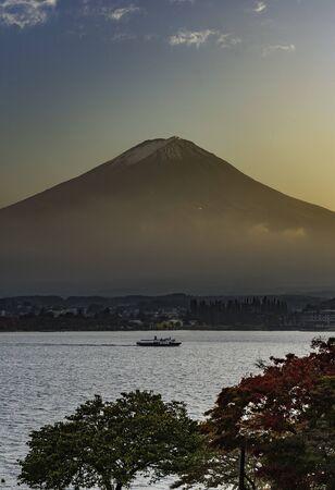 Fishing boat in Lake Kawaguchi with Fuji Mountain background