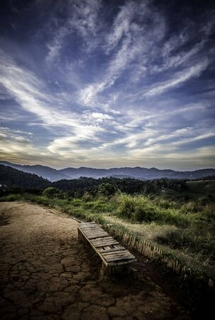 Old bench on the mountain with beautiful sky
