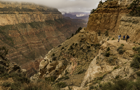 Tourist taking picture Grand Canyon view