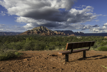 Empty long bench at viewpoint of Mountain