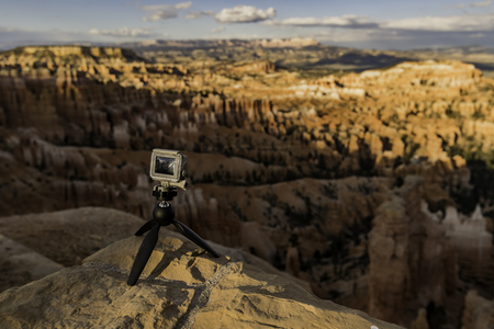 Small camera stand on rock Stock Photo
