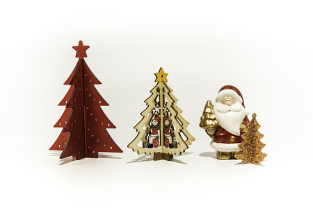Three Christmas trees with Santa Claus isolated on white background Stock Photo