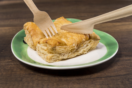 Pineapple pie on white plate with fork and knife Stock Photo