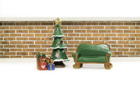 Empty green long bench near Christmas tree and gifts