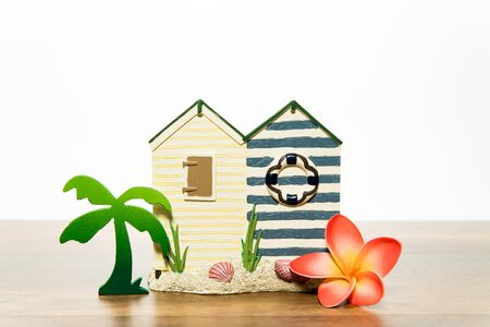 House with palm tree and orange plumeria Stock Photo