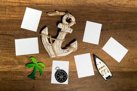 Blank paper sheet with boat, anchor, palm tree, and compass decoration Stock Photo