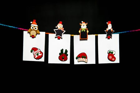 Hanging white paper sheet on colorful rope with Christmas theme paper clip and Christmas decoration