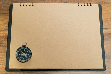 Blank brown paper with black compass on top Stock Photo