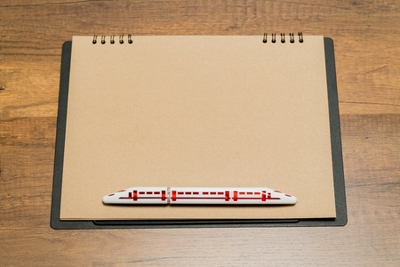 Blank brown paper sheet with train shape pen Stock Photo