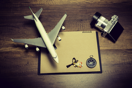 Blank brown sheet with air plane model, camera and compass Stock Photo
