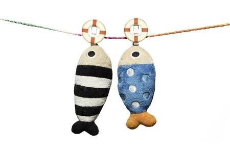 two pillows fish shape hanging on the rope isolated on white background