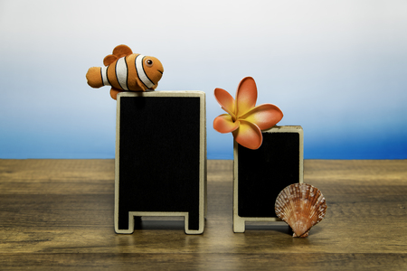 Blank promotion board with Clown fish and sea shell and flower