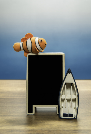 Clown fish over blank back board and boat