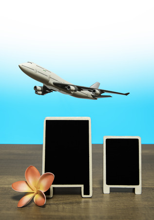 Air plane flying over promotion board with flower Stock Photo