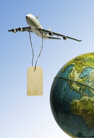 One airplane hanging with black wooden price tag over the earth